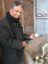 Sana Hastakala workshop owner Kalayan Krishna Tamraka and his singing bowls