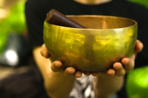 hands holding a singing bowl