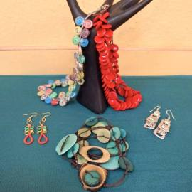 Recycled newspaper, poptab and telephone wire jewelry, $16-24; Tagua nut sustainable jewelry, $18-39